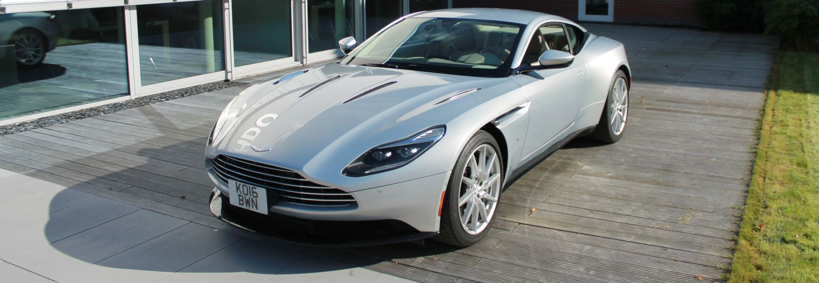 Decorative element exterior on a silver Aston Martin