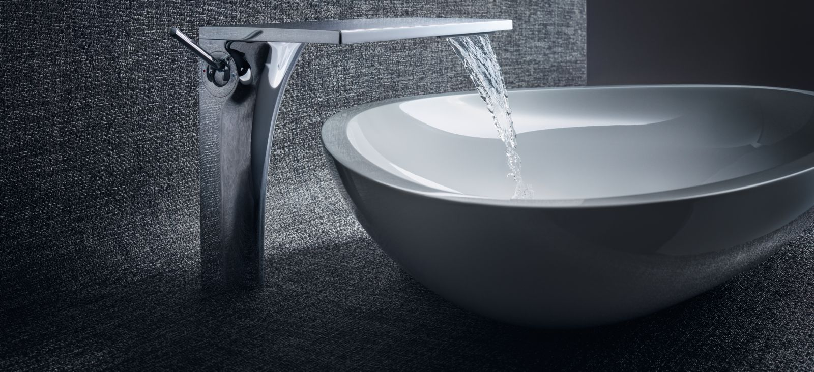Silver faucet lets water into the sink